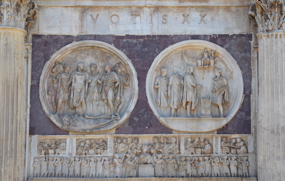Reliefs from the South side of the Arch of Constantine, 312-315. Roundels date to the era of Hadrian, c. 117-138 C.E. and the frieze, Showing the distribution of Largesse dates to the time of Constantine, 312-315 C.E.