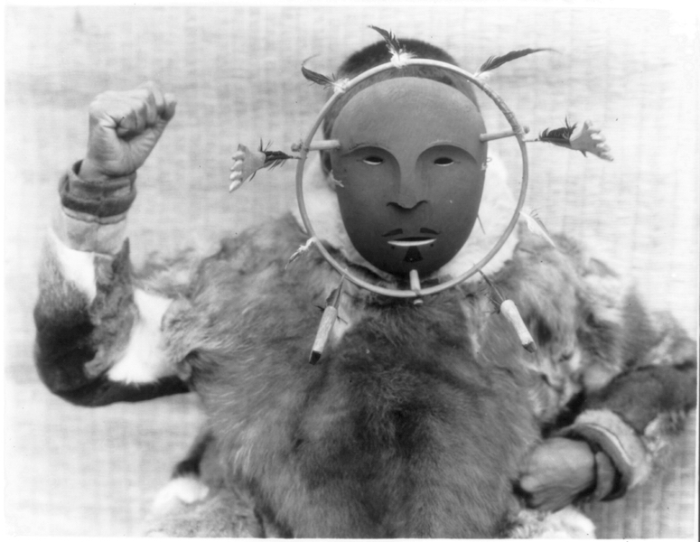 Edward S. Curtis, A man wearing a ceremonial mask of the Nunivak style, c. 1929, photograph (Edward S. Curtis Collection, Library of Congress)