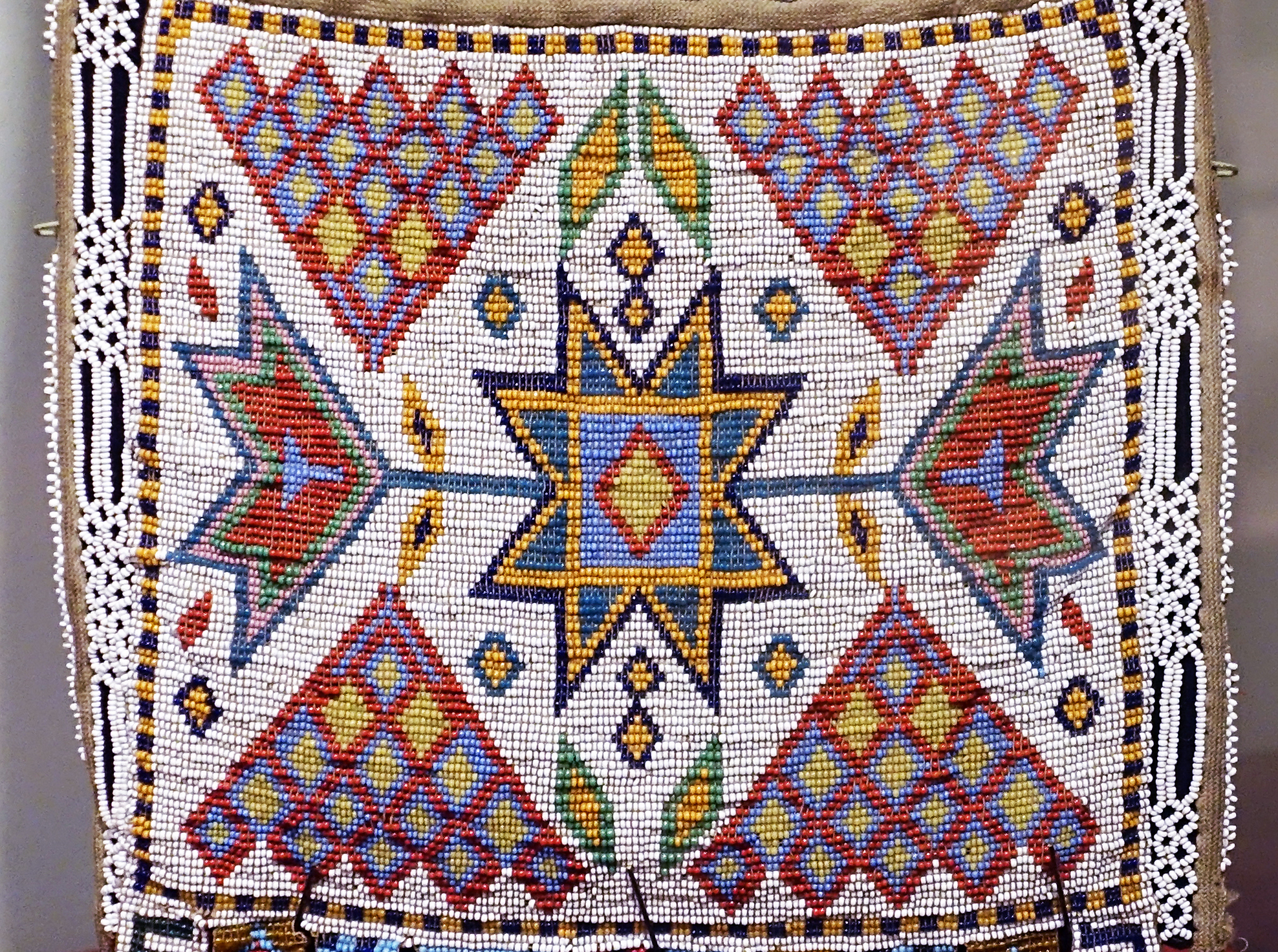Detail, Bandolier Bag, Western Great Lakes, late 19th century, broadcloth, wool, cotton, beads, brass buttons