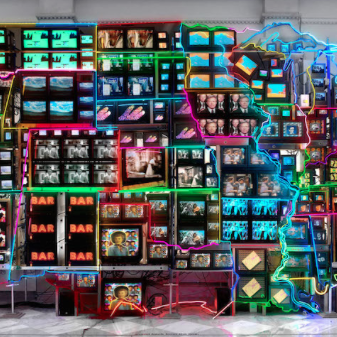 Nam June Paik, Electronic Superhighway: Continental U.S., Alaska, Hawaii, 1995, fifty-one channel video installation (including one closed-circuit television feed), custom electronics, neon lighting, steel and wood; color, sound, approx. 15 x 40 x 4' (Smithsonian American Art Museum) (© Nam June Paik Estate)
