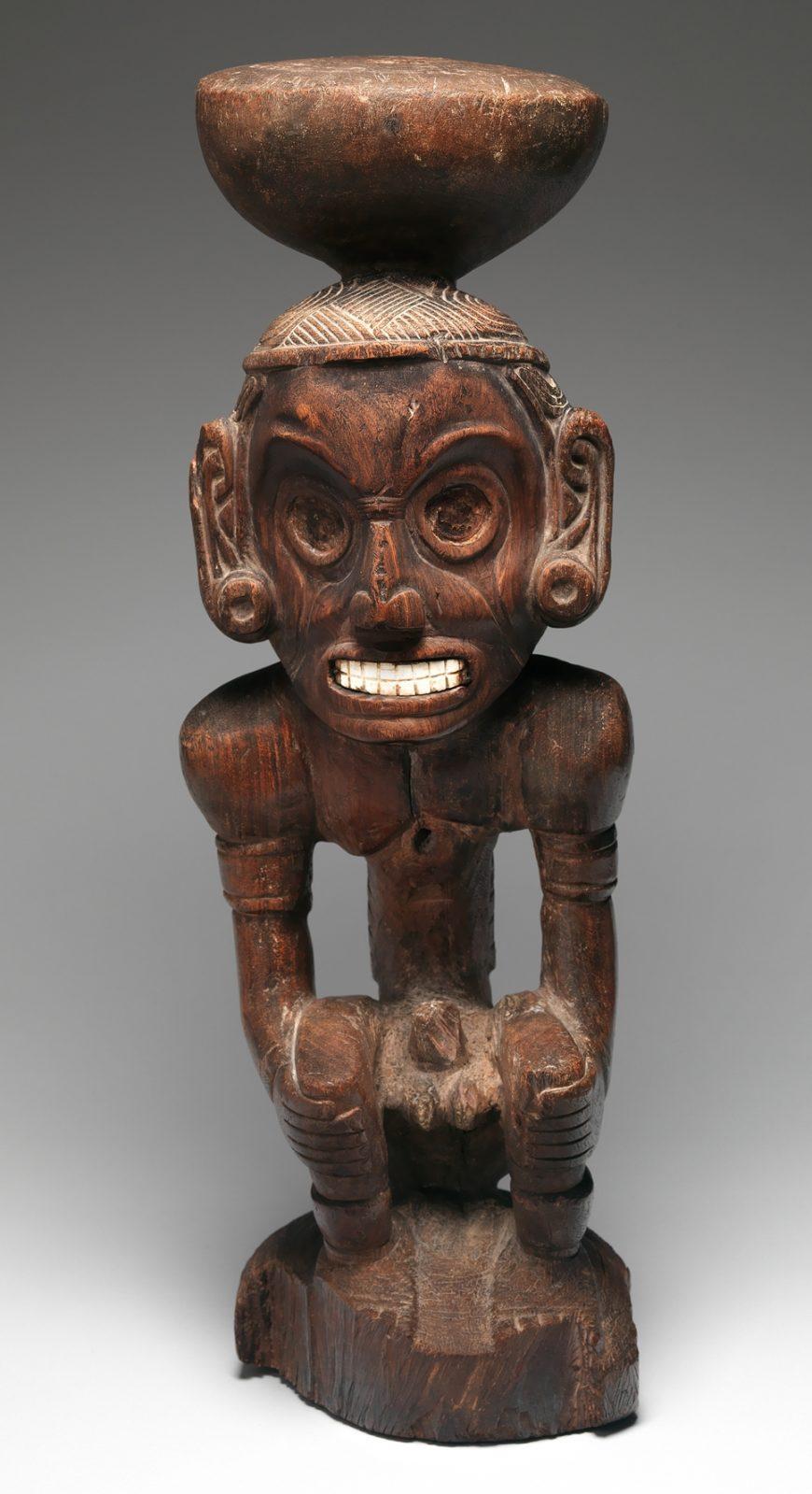 Deity Figure (Zemi), c. 1000, Dominican Republic, wood, shell, 68.5 x 21.9 x 23.2 cm (The Metropolitan Museum of Art)