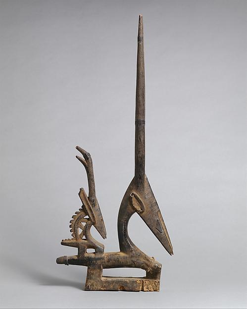 Headdress (Ci Wara): Female Antelope, 19th–20th century Mali, Bamako region, Bamana, wood, metal bands, 71.2 cm high (The Metropolitan Museum of Art)