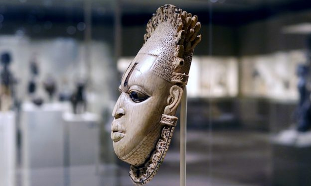 Queen Mother Pendant Mask (Iyoba), 16th century, Edo peoples, Court of Benin, Nigeria, ivory, iron, copper, 23.8 x 12.7 x 8.3 cm (The Metropolitan Museum of Art)
