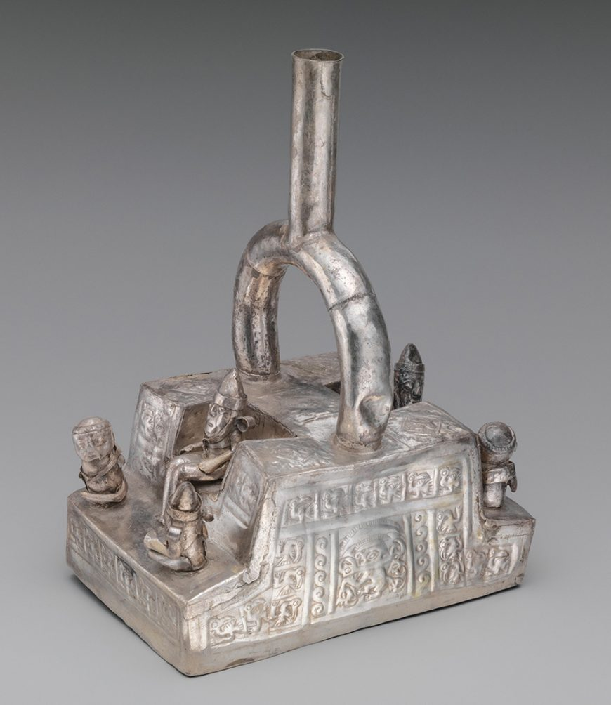 Chimú bottle depicting a throne with figures, 1300–1500, Peru, silver, 23.5 x 11.1 x 16.5 cm (The Metropolitan Museum of Art)