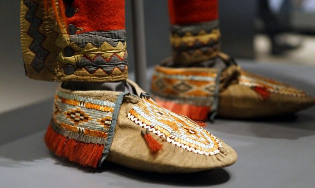 Anishinaabe outfit, c. 1790, collected by Lieutenant Andrew Foster, Fort Michilimackinac (British), Michigan, Birchbark, cotton, linen, wool, feathers, silk, silver brooches, porcupine quills, horsehair, hide, sinew; the moccasins were likely made by the Huron–Wendat people (National Museum of the American Indian, Smithsonian Institution)