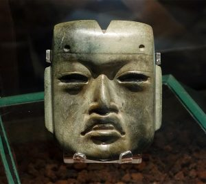 Olmec mask, c. 1200-400 B.C.E., jadeite, 4 x 3-3/8 x 1-1/4 inches, found in offering 20, buried c. 1470 C.E. at the Aztec Templo Mayor (Museo del Templo Mayor, Mexico City) (photo: Dr. Steven Zucker)
