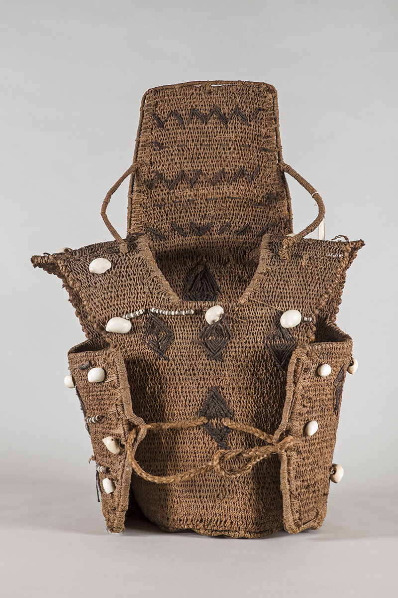 Kiribati cuirass with neck guard, 19th century or earlier, rope-work ornamented with shells, black string patterns, and beads, 72.5 x 58.2 x 32 cm (Pitt Rivers Museum)