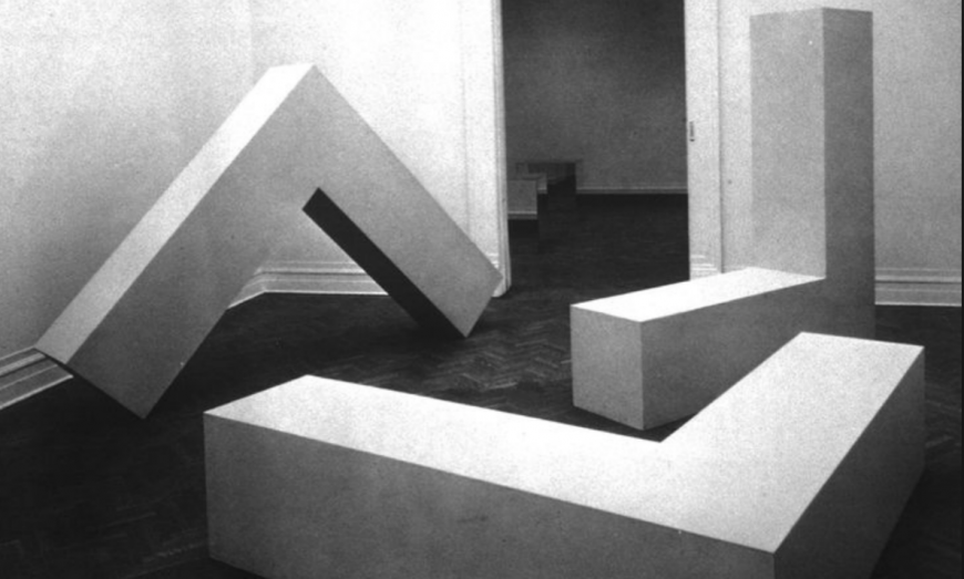Robert Morris, Untitled (L-Beams), 1965, originally plywood, later versions made in fiberglass and stainless steel, 8 x 8 x 2'
