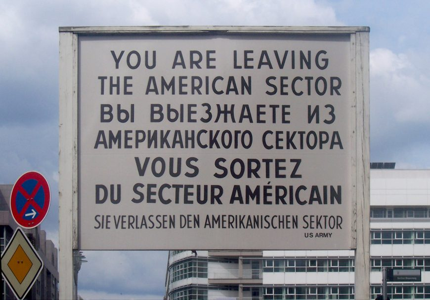 The sign at Checkpoint Charlie, between the American and Soviet sectors (East and West Berlin), photographed 2005 (photo: Henry Robbert, CC0)