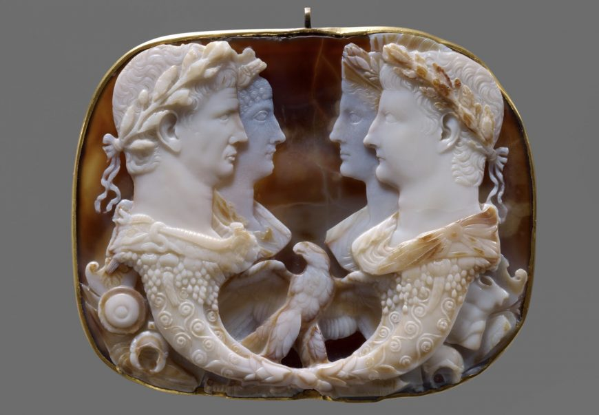 Gemma Claudia, 49 C.E., 120 x 152 cm without setting, five-layered onyx and 18th century gold band (Kunsthistorisches Museum, Vienna); Emperor Claudius (left), his fourth wife, Agrippina the Younger behind him, her parents are opposite, Germanicus, brother of the emperor, and behind him his wife, Agrippina the Elder