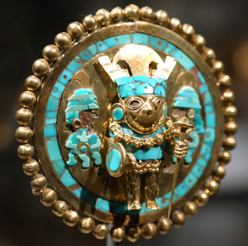 Ear ornament depicting a warrior, 640–680, gold, turquoise, and wood, 9.5 cm diameter (photo: Steven Zucker, CC BY-SA 4.0)