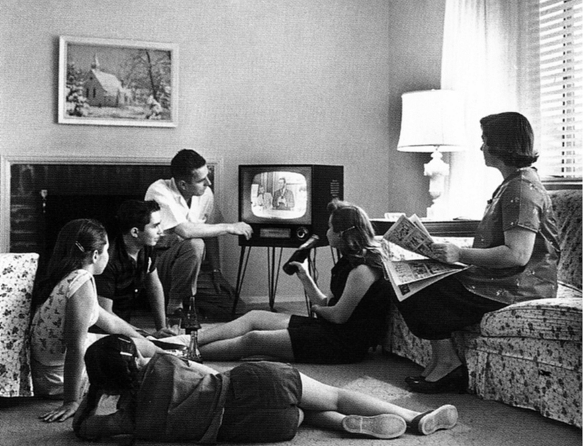 A family watches television, c. 1958 (National Archives and Records Administration, public domain)