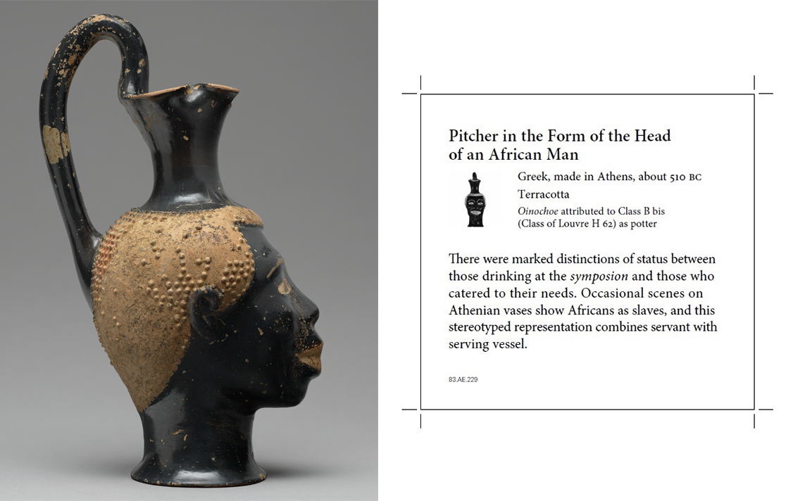 Pitcher (Oinochoe) in the Form of the Head of an African, with the label that accompanies it in Athenian Vases (Gallery 103) at the Getty Villa