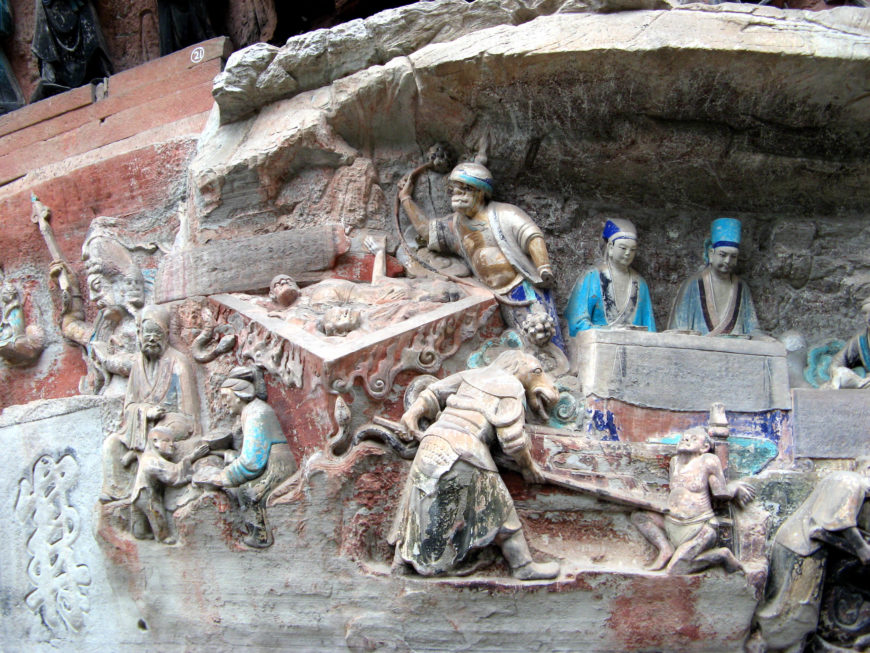 Scenes of torture (a vat of excrement and impalment) on the Hell Tableau, Niche 20, Dafowan, Mt. Baoding, Dazu. Southern Song Dynasty (photos: G41rn8, CC BY-SA 4.0)