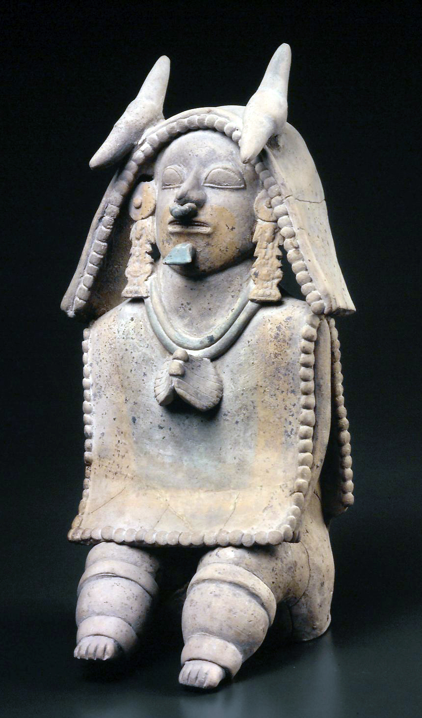 Seated Figure, Jama-Coaque culture, Ecuador, 500 BCE-500 CE, clay with post-fire paint, 13 x 6 3/4 inches. Brooklyn Museum.
