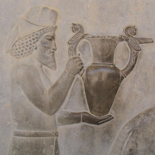 An Armenian tribute bearer carrying a metal vessel with Homa (griffin) handles, relief from the eastern stairs of the Apādana in Persepolis (Fars, Iran), c. 520–465 B.C.E. (photo: Aryamahasattva, CC BY-SA 3.0)